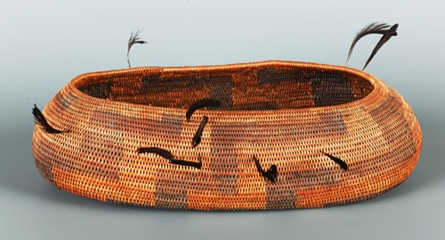 Canoe-shaped bowl with quail topknots, early 20th century, Native American, Californian, Pomo, willow, sedge root, bracken fern root, quail feathers, 1 3/4 × 6 1/4 × 2 1/4in., Gift of the Estate of Robert M. Shields, 2013.4.13. Currently on view in the Native American art galleries, Seattle Art Museum.