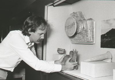 Exhibition designer (and currently our venerable head of the Museum Services Division) Michael McCafferty installs rhyton in a case, 1983, Photo: Paul Macapia
