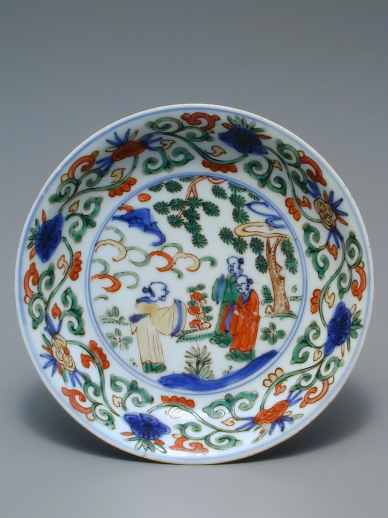Jingdezhen ware saucer, Chinese, Ming dynasty (reign of the Wan Li emperor, 1573-1619), porcelain with decoration in underglaze-blue, overglaze-enamels, height 1 in., diameter 5 7/16 in., Eugene Fuller Memorial Collection, 51.90. On view beginning 30 April, Chinese art galleries, Asian Art Museum.