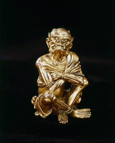 Seated demon figure, 14th century, Chinese, bronze with gilt, 3 1/4 x 2 x 1 7/8 in., Eugene Fuller Memorial Collection, 52.45. Currently on view at the Asian Art Museum.