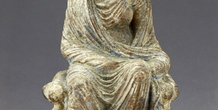 Seated tanagra figurine, 4th–3rd century B.C., Greek, Boeotia, Hellenistic period (ca. 323-31 B.C.), terracotta, pigment, 6 1/2 x 3 5/8 x 4 1/2 in., Norman and Amelia Davis Classical Collection, 66.101. Currently on view in the Ancient Mediterranean and Islamic art gallery, fourth floor, SAM downtown.