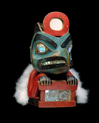 Lkaayaak yeil s'aaxw (Box of Daylight Raven Hat), ca. 1850, Native American, Tlingit, Taku, Gaanax'adi clan, maple, mirror, abalone shell, bird skin, paint, sea lion whiskers, copper, leather, Flicker feathers, 11 7/8 x 7 3/4 x 12 1/4in., Gift of John H. Hauberg, 91.1.124. Currently on view in the Native American art galleries, Seattle Art Museum.