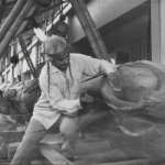 Joseph Hillaire Carving Kobe-Seattle Sister Friendship Pole in front of Kobe City Hall. Image courtesy of The Seattle Public Library.