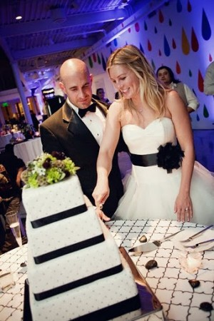 The bride and groom cutting the cake at the reception