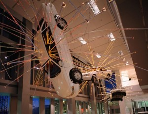 Inopportune: Stage One, 2004, Cai Guo-Qiang, Chinese, (works in America), born 1957, cars and sequenced multi-channel light tubes each car: 16' x 6', Seattle Art Museum, Gift of Robert M. Arnold, in honor of the 75th Anniversary of the Seattle Art Museum, © Cai Guo-Qiang, Photo by Eduardo Calderón