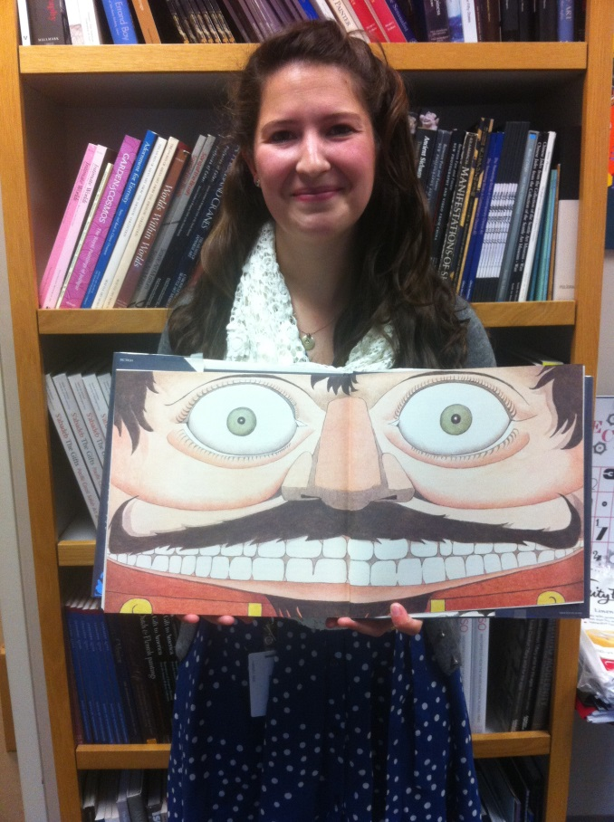 Intern Kaley Ellis, with the Maurice Sendak-illustrated Nutcracker book