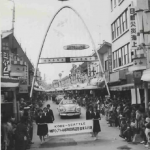Parade featuring Joseph Hillaire travels through Motomachi Street . Image courtesy of The Seattle Public Library.