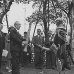 Joseph Hillaire presents model totem pole to Major Haraguchi. Image courtesy of The Seattle Public Library.