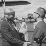 Mr. Koyama, Chief Foreign Affairs Officer, greets Joseph Hillaire at the Airport. Image courtesy of The Seattle Public Library.