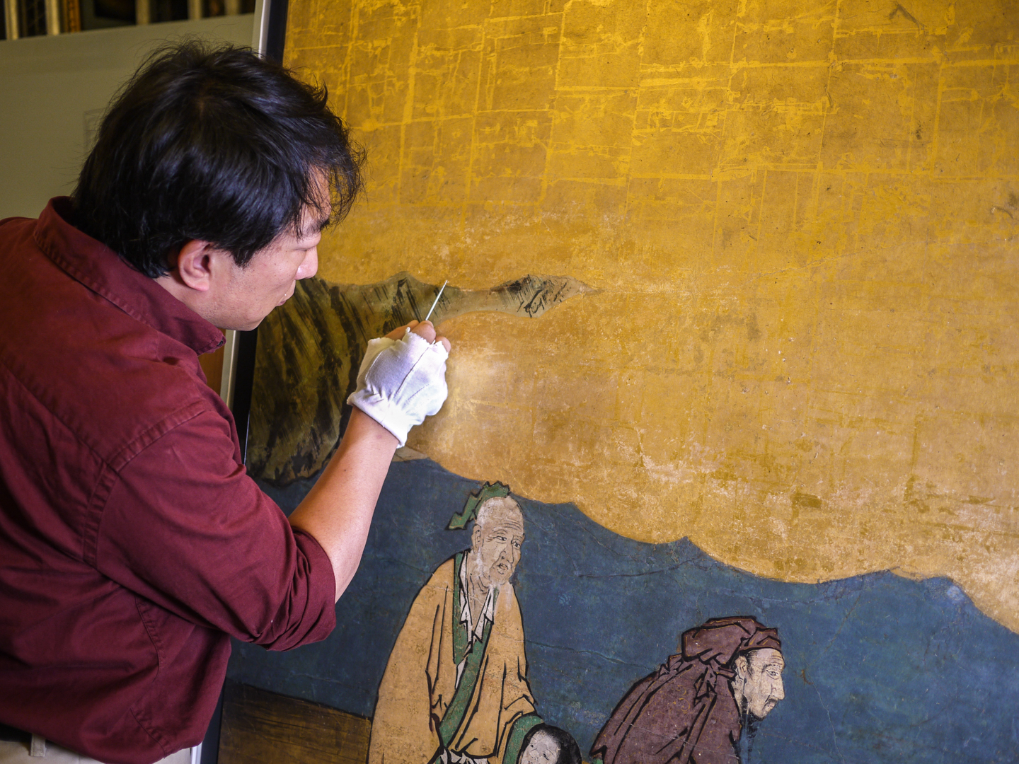 A Conservator working on a Chinese painting