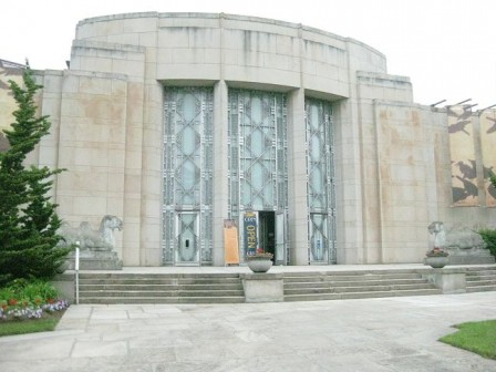 Front entrance of Seattle Asian Art Museum with camels and art deco doors.