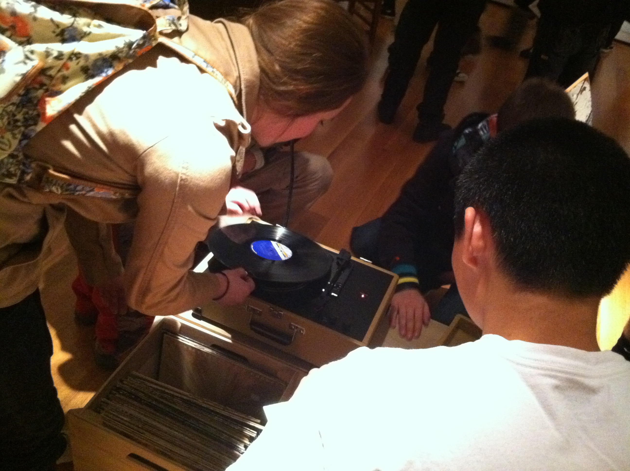 Teens exploring record players in Theaster Gates: The Listening Room at the Seattle Art Museum