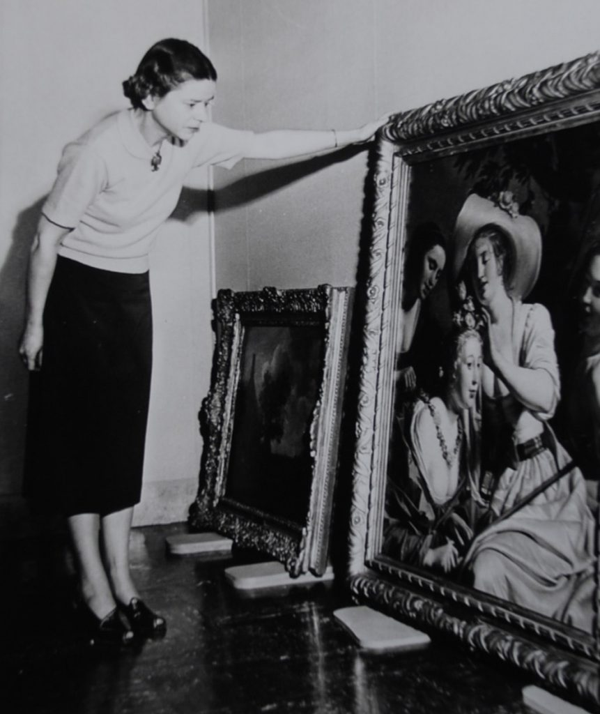 Dottie Malone examining the painting