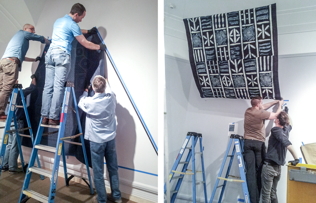 The SAM team hanging tapestries