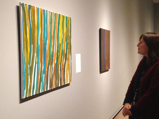 Katie Morris, looking at paintings by Emily Kngwarreye, promised gifts of Margaret Levi and Robert Kaplan, all paintings © Emily Kngwarreye. Currently on view in the Australian Aboriginal art gallery, Seattle Art Museum.