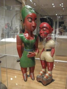 """Male and Female Figures,"" wood, paint, Ivorian, Baule & ""Pair of Harps,"" wood, skin, fabric, Congolese, Ngbaka. Photograph by the Author. Taken 4/13/12. JPEG file."